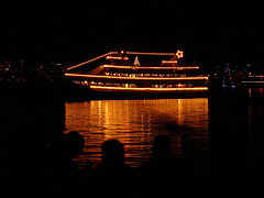 Large boat decorated with white lights